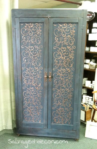 Repurposed cabinet using Miss Mustard Seed's Milk Paint in Curio and Artissimo with an added raised Stencil